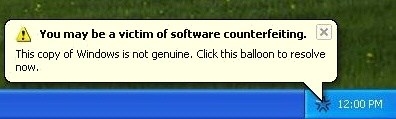 You may be a victim of software counterfeiting. This copy of Windows is not genuine. Click this balloon to resolve now.