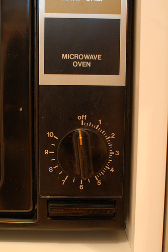 Controls on an older microwave