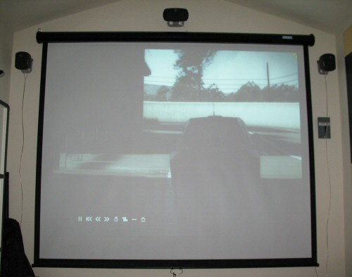 Projector screen and speakers