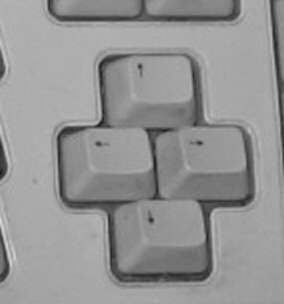 keyboard with non-standard arrow key cluster